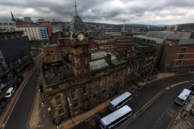 These intriguing images give a rare opportunity to peek behind the locked doors of a once grand and imposing law court which now, after 20-years of disuse, has been left to crumble and rot. See Ross Parry copy RPYURBAN : The Old Town Hall in Sheffield, South Yorks., which housed the city's crown and high court's up until the 1990's, has lain dormant since 1996. The impressive building's glory has faded over the years but remnants of its role as a council chamber and law court are still visible among the decaying timber and moulding carpets. Meeting benches are still scattered across the main room despite nothing having been done with the building, giving the appearance of time standing still. Despite the holes in the ceilings and peeling wallpaper, the aged building refuses to relinquish it's former grandeur - as can be seen in the wooden panelling, the ironwork on the stairs, the ornate fireplaces and huge doorways.