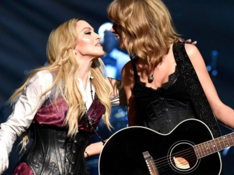 Madonna stays seated after THAT Brits fall before embracing new guitarist Taylor Swift on stage at iHeartRadio Music Awards