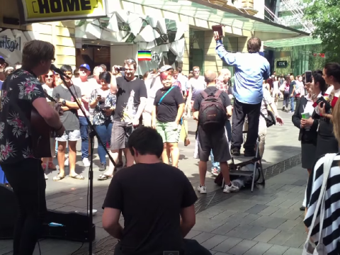 Busker drowns out homophobic preacher with 'Girls Just Want to Have Fun'