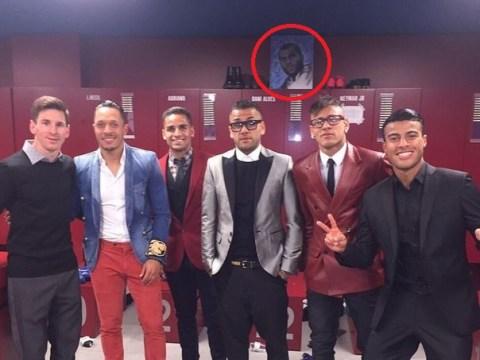 Barcelona defender Dani Alves has a portrait of himself above his locker