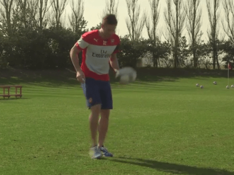 Arsenal striker Olivier Giroud shows off his keepy-uppy skills…with rugby ball