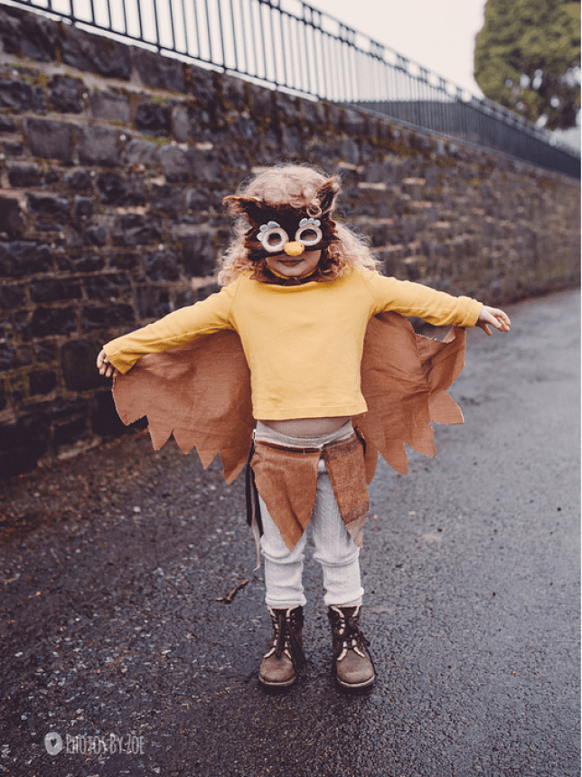 A little girl dressed up as a owl for World Book Day