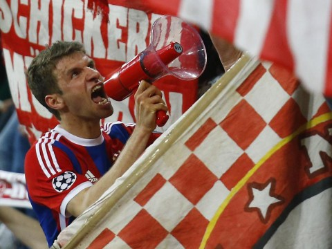 Thomas Muller conducts Bayern Munich fans with megaphone to celebrate setting new Champions League record v Porto