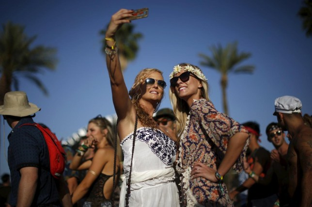 Women pose for a selfie photo at the Coachella Valley Music and Arts Festival in Indio, California April 11, 2015. REUTERS/Lucy Nicholson Lucy Nicholson/Reuters