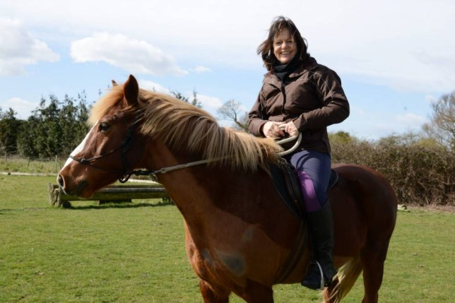 "Cathy Sugden and her horse Mr Smiffy who gave chase across the Romney Marsh after two robbers held up a post office. See MASONS story MNHORSE; Two armed bandits who held up a post office and escaped with the cash were chased by a plucky equestrian on HORSEBACK. Catherine Sugden, 58, was riding her 17 year-old pony Mr Smiffy across a field when she spotted the fleeing robbers who had terrorised staff at her local post office. Not realising who they were but suspicious that they were thieves the duo galloped after them for 500 yards. The bandits got away but she alerted police who launched a massive manhunt with armed officers and a helicopter. Mrs Sugden, a horse behaviour specialist, said: ""It was all a little bizarre."