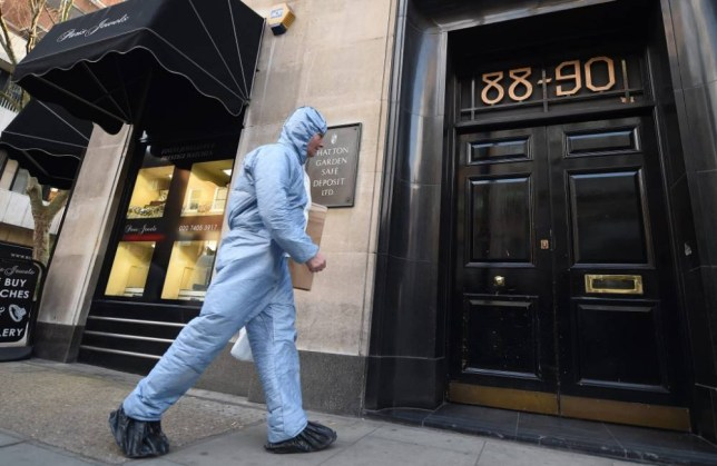 epa04694707 A forensics expert enters the Hatton Garden Safe Deposit Ltd store in London, Britain, 07 April 2015. London Metropolitan Police state that police were called to a report of a burglary at the Hatton Garden Safe Deposit company in the London jewellery quarter, Hatton Garden, in the City of London, England, on 07 April 2015. In the break in it appears that heavy cutting equipment has been used to get into a vault at the address, and a number of safety deposit boxes have been broken into, It is believed to have happened over the Easter bank holiday weekend.  EPA/ANDY RAIN