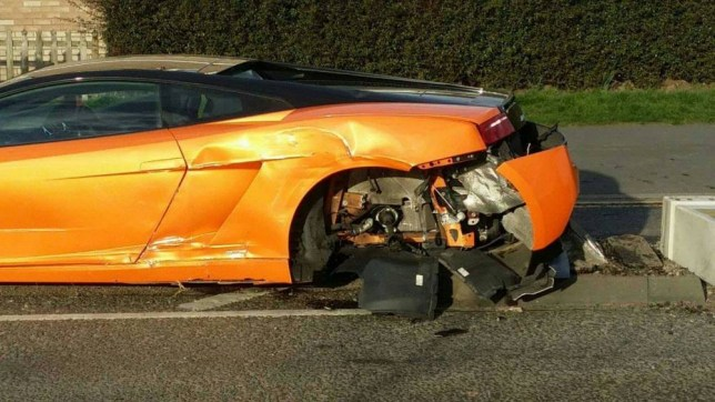 PIC FROM MARTIN JOHNSON / CATERS NEWS - (PICTURED: The aftermath of the Lamborghini crash.) A driver reportedly laughed after writing off his 250k Lamborghini when he crashed into a tree just metres from a primary school. One of the wheels from the bright orange sports car flew off and was reported to have narrowly missed a child and her grandfather, when the unidentified driver lost control of the 202mph supercar in Beaumont Leys, Leics.The Lamborghini Gallardo which can reach 0-60mph in 3.4 seconds hit a tree before careering into the middle of the road and smashing into a bollard. After smashing into a bollard, luckily, the 5.2 litre vehicle stopped just short of Buswells Lodge Primary School, merely metres away from a school fence. These shocking pictures show the aftermath of the incident. SEE CATERS COPY.