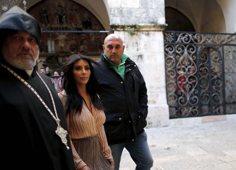 U.S. reality TV star Kim Kardashian (2ndL) leaves the Cathedral of Saint James after a baptism ceremony in Jerusalem's Old City April 13, 2015. In a quick visit to Jerusalem, American reality TV star Kardashian and rapper Kanye West had their toddler daughter, North West, baptized on Monday at a 12th century Armenian church in the old walled city. REUTERS/Ammar Awad