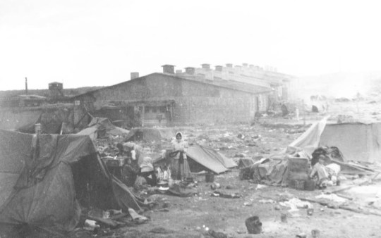Bergen-Belsen concentration camp as pictured by  Reverend Charles Martin King Parsons.  A British army chaplain present at the liberation of Anne Frankís Nazi concentration camp captured the true horror of the shameful event in a series of never-seen-before photographs ñ showing evidence of mass slaughter.  See SWNS story SWNAZI.  The pictures, released yesterday (Tues) to mark the 70th anniversary of the liberation of Bergen-Belsen today (Weds), were taken by Reverend Charles Martin King Parsons.  Army Chaplain Charles, from Leicestershire, was present during the liberation of the camp, in Northern Germany, where an estimated 50,000 people, including Anne Frank, were killed.  The shocking black-and-white images include pictures of the camp burning to the ground, as well as horrific mass graves which could have contained the remains of the young Jewish diarist.  Great-grandson Tom Marshall, 27, decided to publish the shocking images after finding the pictures tucked inside an old box among his grandmotherís possessions.