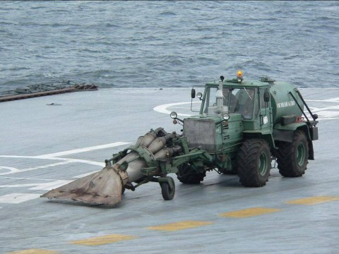 Why strap a jet engine to a tractor? To clean an aircraft carrier of course