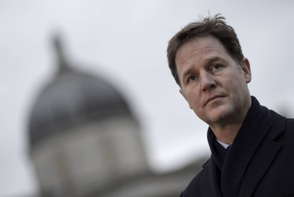 """British Deputy Prime Minister Nick Clegg attends a rally in Trafalgar Square in central London on January 11, 2015 to commemorate the victims of the attacks in France that killed 17 people and injured scores more. Around 2,000 people gathered in London to honour the victims of Islamist attacks in Paris, many raising pencils to the sky in memory of those killed at satirical weekly Charlie Hebdo. Some in the crowd at Trafalgar Square carried placards saying """"Je suis Charlie"""" and waved French flags.  AFP PHOTO / NIKLAS HALLE'N        (Photo credit should read NIKLAS HALLE'N/AFP/Getty Images)"""
