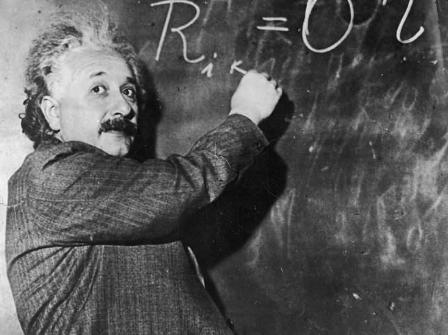 00/00/1930. The scholar Albert EINSTEIN, inventor of the theory of relativity, writes a mathematical formula on a blackboard. En 1930, le savant Albert EINSTEIN, inventeur de la thÈorie de la relativitÈ, Ècrit sur un tableau noir une formule mathÈmatique.