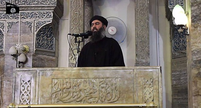Mandatory Credit: Photo by Sipa Press/REX Shutterstock (3894675f)  Video still of the leader of the militant Islamic State Abu Bakr al-Baghdadi  The leader of the militant Islamic State Abu Bakr al-Baghdadi at a mosque in Mosul, Iraq - 05 Jul 2014  The leader of the militant Islamic State Abu Bakr al-Baghdadi has made what would be his first public appearance at a mosque in the centre of Iraq's second city, Mosul, according to a video recording posted on the Internet on July 5, 2014, in this still image taken from video. There had previously been reports on social media that Abu Bakr al-Baghdadi would make his first public appearance since his Islamic State in Iraq and the Levant (ISIS) changed its name to the Islamic State and declared him caliph. The Iraqi government denied that the video, which carried Friday's date, was credible. It was also not possible to immediately confirm the authenticity of the recording or the date when it was made.