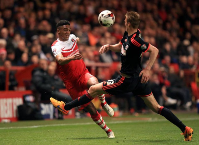Charlton Athletic's Joe Gomez (left) and Fulham's Dan Burn (right) battle for the ball