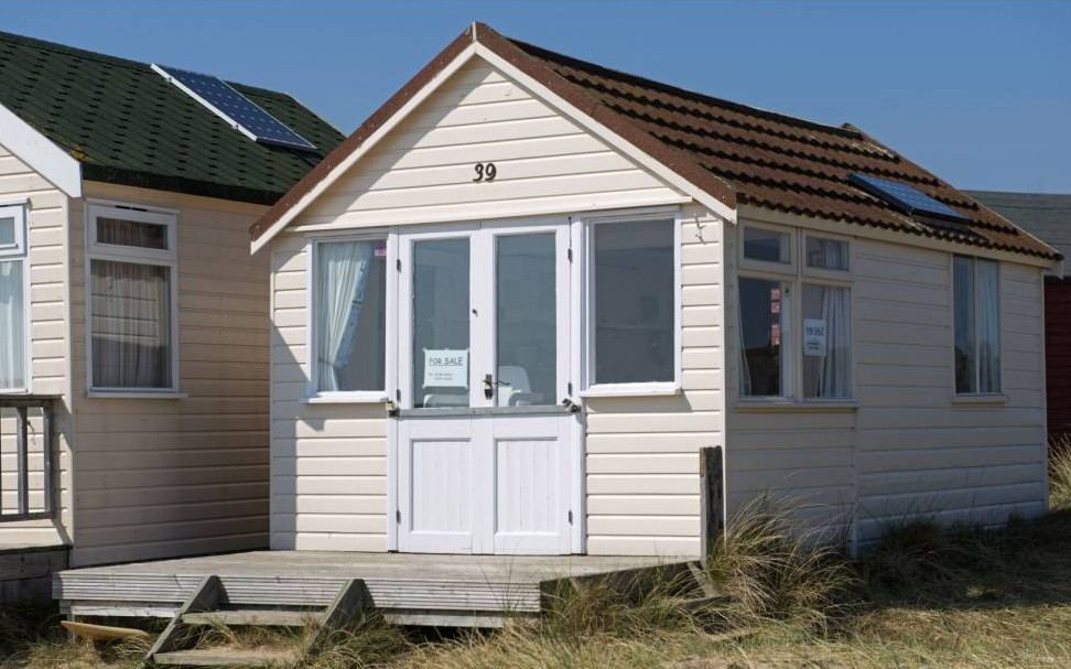 Dorset beach hut on sale for £230,000