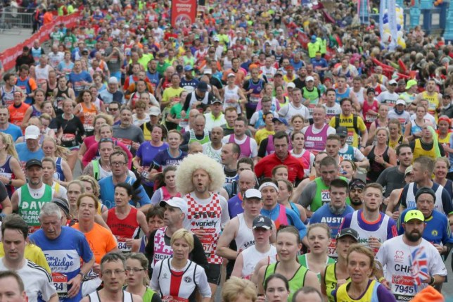 Runners make their way over Tower Bridge in London during the 35th London Marathon, Sunday, April 26, 2015. (AP Photo/Tim Ireland)
