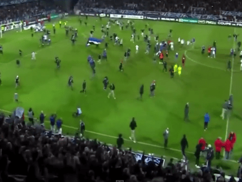 They think it's all over! Auxerre fans storm pitch only to find out the game isn't over