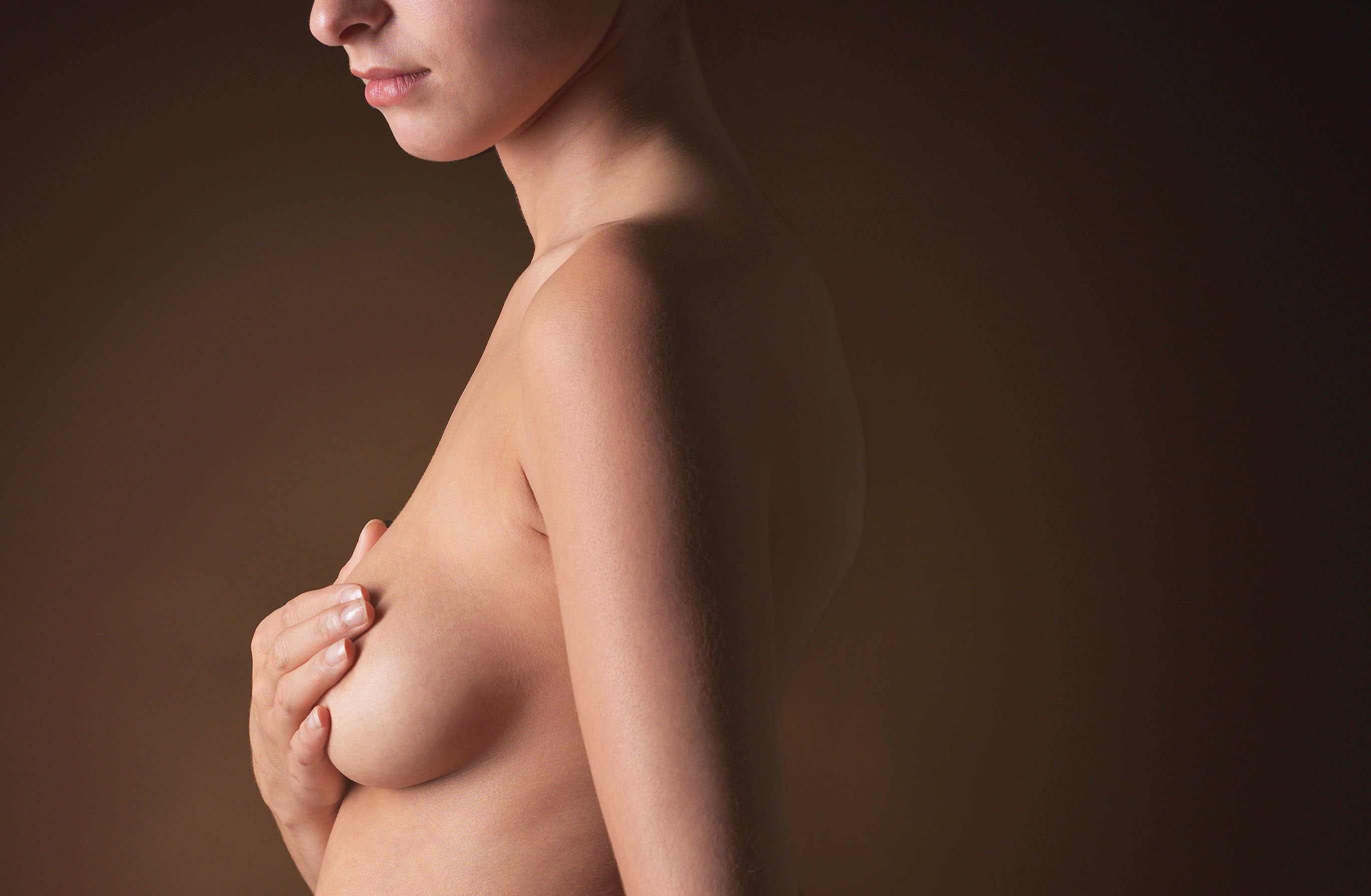 A woman checking her breastalamy