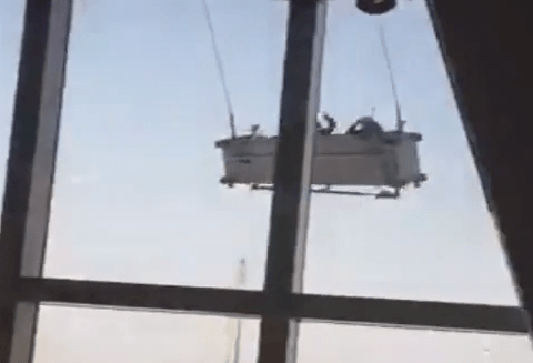 This is what it's like to clean the windows of a Shanghai skyscraper in high wind
