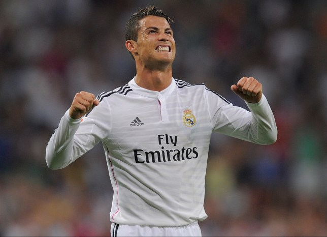 MADRID, SPAIN - AUGUST 25:  Cristiano Ronaldo of Real Madrid celebrates after scoring Real's 2nd goal during the La liga match between Real Madrid CF and Cordoba CF at Estadio Santiago Bernabeu on August 25, 2014 in Madrid, Spain.  (Photo by Denis Doyle/Getty Images)