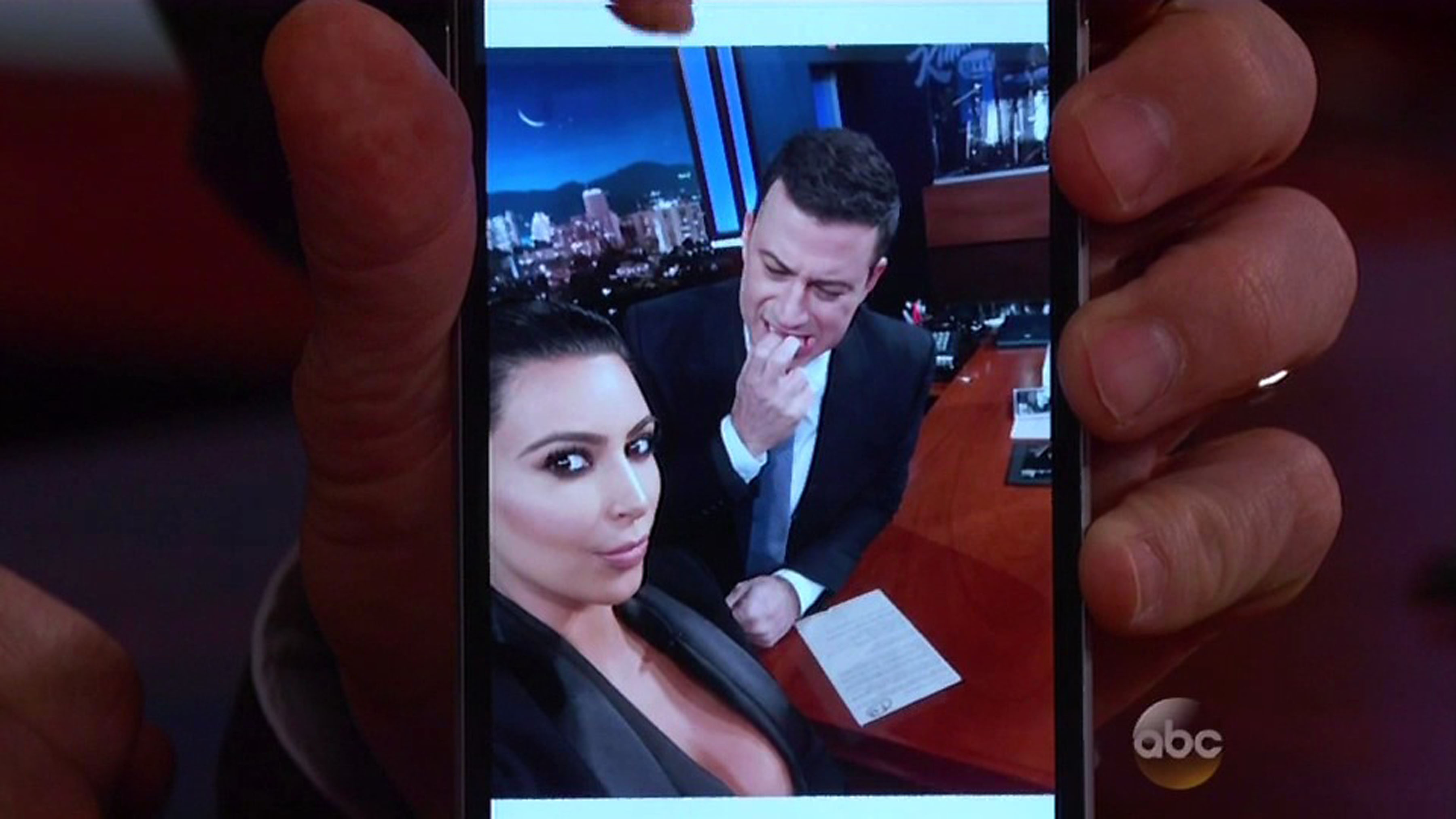 'I am going to try to not look at your breasts': Jimmy Kimmel is caught checking out Kim Kardashian