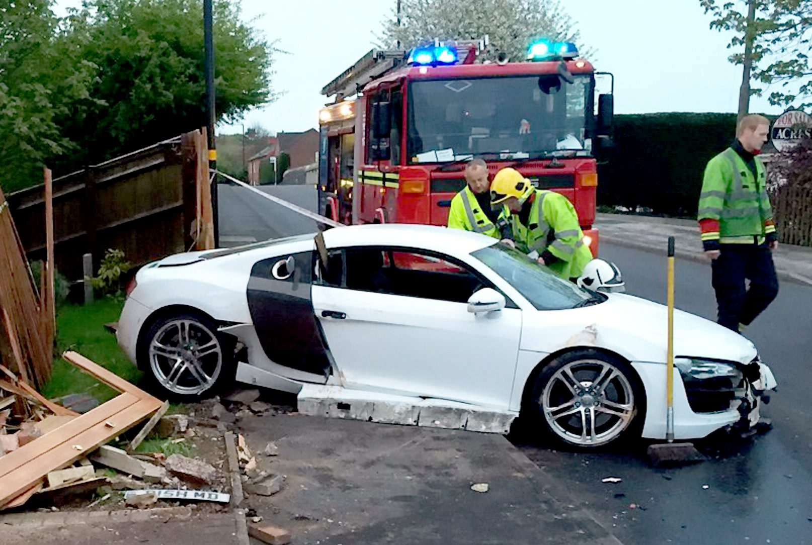 The dramatic aftermath when a £100,000 sports car lost control and smashed into a house in Sutton Coldfield. (Picture: NTI)