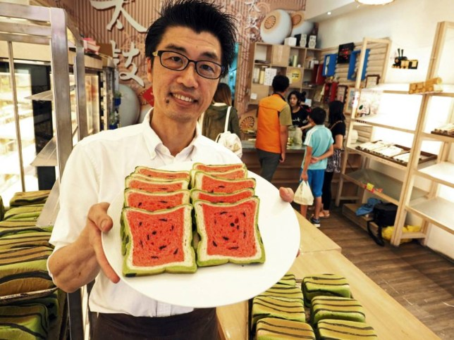 epa04742677 Lee Wen-fa poses with the 'watermelon toast' at his Jimmy's Bakery in Jiaohsi Township, Yilan County, northern Taiwan, 11 May 2015. Lee began making 'watermelon toast' in April 2015 to make toast interesting to children as kids lose their appetite in summer when the weather gets hot. He uses tea powder, strawberry, bamboo charcoal and food dye to creat the green, red, dark and yellow colors in the toast. The bakery used to sell about 100 loafs of toast in the past, but is now selling 1,500 loafs of the 'watermelon toast' and still cannot keep up with the orders which are coming in from all over the island.  EPA/DAVID CHANG  EPA/DAVID CHANG