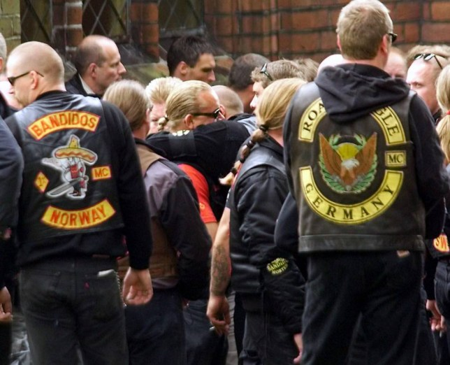 HORSENS, DENMARK - SEPTEMBER 3:  Members and supporters of the motorcycle gang, Bandidos, of Denmark, Norway, Sweden and Germany participate in the funeral of Danish Bandido Morten Viggo Laursen 04 September 1999 in Horsens, east Jutland. Members of the rival Hells Angels were also at the funeral despite the war between the Danish divisions of the two gangs in 1997 in Denmark. Laursen was shot dead in his appartment Sunday 29 August 29 1999.  (Photo credit should read ERNST VAN NORDE/AFP/Getty Images)