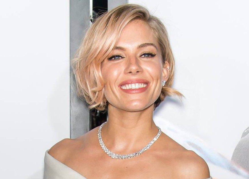 """NEW YORK, NY - DECEMBER 15: Actress Sienna Miller attends the """"American Sniper"""" New York Premiere at Frederick P. Rose Hall, Jazz at Lincoln Center on December 15, 2014 in New York City. (Photo by Gilbert Carrasquillo/FilmMagic)"""