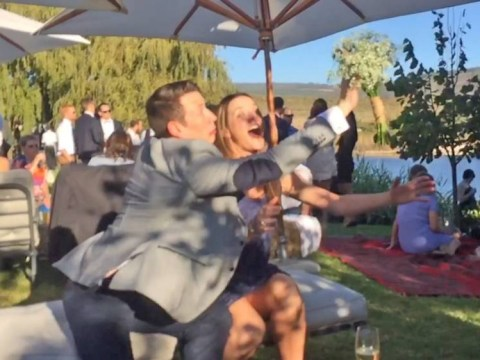 Hilarious moment guy pushes the bridal bouquet away from his girlfriend as she goes to catch it