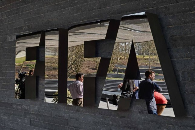 (FILES) This file photo taken on March 20, 2015 shows members of the media waiting next to the logo of the worlds football governing body FIFA at their headquarters in Zurich.  Top FIFA officials were arrested early on May 27, 2015 by Swiss police acting on US corruption charges, The New York Times reported.   AFP PHOTO / FILES / MICHAEL BUHOLZERMICHAEL BUHOLZER/AFP/Getty Images