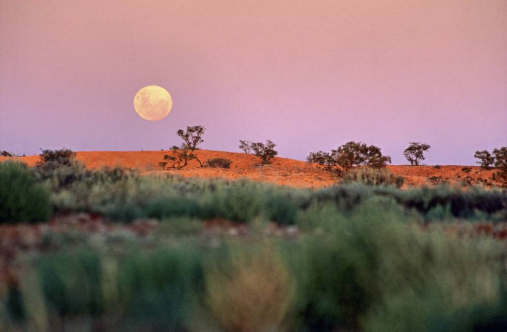 (GERMANY OUT) South Australia - full moon over Australian outback landscape near Coober Pedy (Photo by Mayall/ullstein bild via Getty Images)