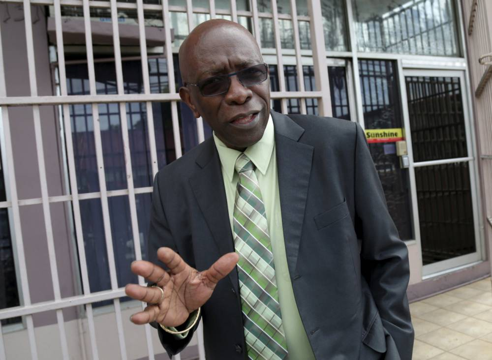 Trinidad and Tobago's former National Security Minister and former FIFA Vice President, Jack Warner, gestures after leaving the offices of the Sunshine Newspaper which he owns, in Arouca, East Trinidad, May 27, 2015. Seven of the most powerful figures in global soccer faced extradition to the United States on corruption charges after their arrest on Wednesday in Switzerland, where authorities also announced a criminal investigation into the awarding of the next two World Cups. One of those indicted, former FIFA Vice President Jack Warner of Trinidad, solicited $10 million in bribes from the South African government to host the 2010 World Cup, the Justice Department said. Warner issued a statement saying he is innocent of any charges. REUTERS/Andrea De Silva      TPX IMAGES OF THE DAY