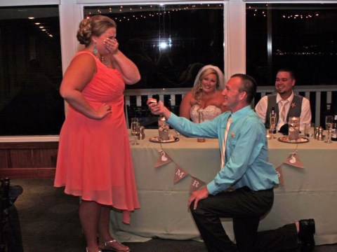 Don't upstage the bride: Wedding guest's proposal totally steals bride's thunder
