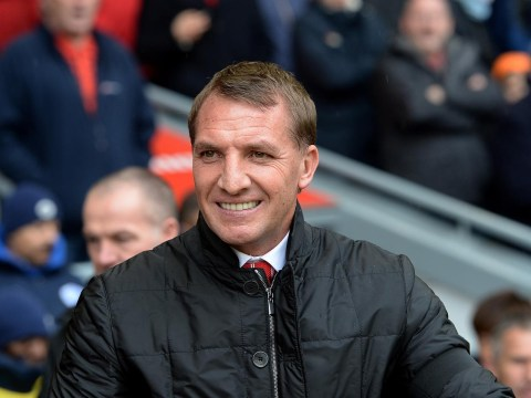 Liverpool boss Brendan Rodgers shrugs off banner calling for his head, jokes it must have been from agent of Rafael Benitez