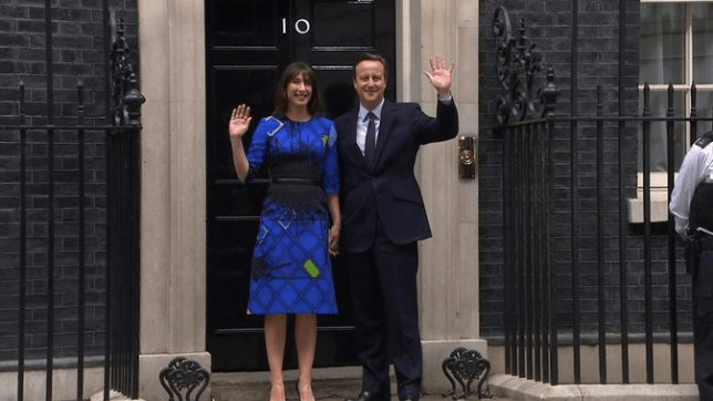 David and Samantha Cameron stand outside the door of Number 10