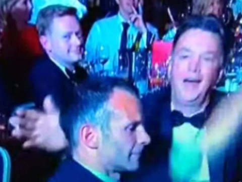 Manchester United boss Louis van Gaal slaps Ryan Giggs at Player of the Year awards