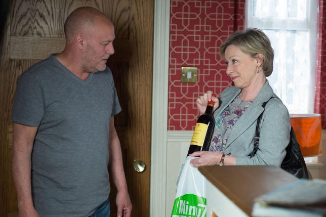 WARNING: Embargoed for publication until 23/06/2015 - Programme Name: EastEnders - TX: 30/06/2015 - Episode: 5094 (No. n/a) - Picture Shows: Carol suggests a drink to Buster.  Andrew 'Buster' Briggs (KARL HOWMAN), Carol Jackson (LINDSEY COULSON) - (C) BBC - Photographer: Jack Barnes