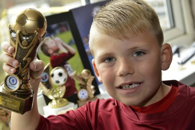 "A seven-year-old named after Steven Gerrard is hoping to follow in the Liverpool star's footsteps - after scoring a staggering 97 goals in just one season.  Blaze Gerrard-Carl Brown has scored from the halfway line and in two matches against the same side found the net an incredible 16 times - despite playing one half in goal. The 4ft-tall youngster hopes to follow in the steps of the England star he was named after and become ""the new Steven Gerrard.""  Pint-sized Blaze, who is from Brighton, East Sussex, and plays for Woodingdean Youth Blue under-sevens in the county, has also scored 16 other goals in two separate tournaments this season.  SEE OUR COPY FOR DETAILS. Pictured:  Blaze Gerrard-Carl Brown. © Brighton Argus/Solent News & Photo Agency UK +44 (0) 2380 458800"