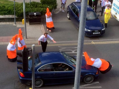 Group of stags dressed as traffic cones bring traffic in Newquay to a halt