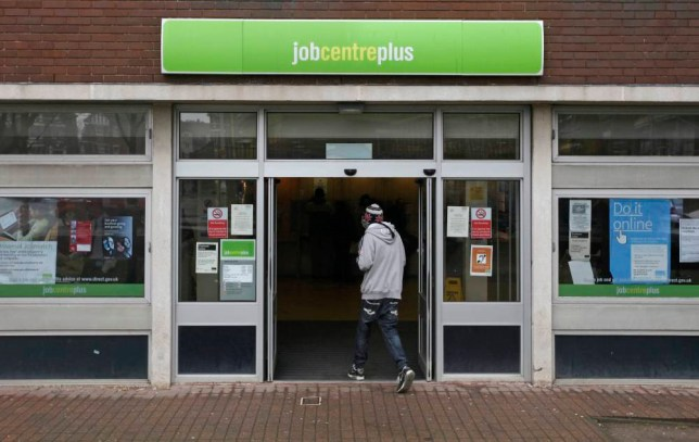 A jobseeker enters a job centre in Folkestone, U.K., on Tuesday, April 9, 2013. Jobless claims fell less than economists forecast in February and a wider unemployment measure rose for the first time in a year as the number of young people seeking work climbed. Photographer: Chris Ratcliffe/Bloomberg via Getty Images