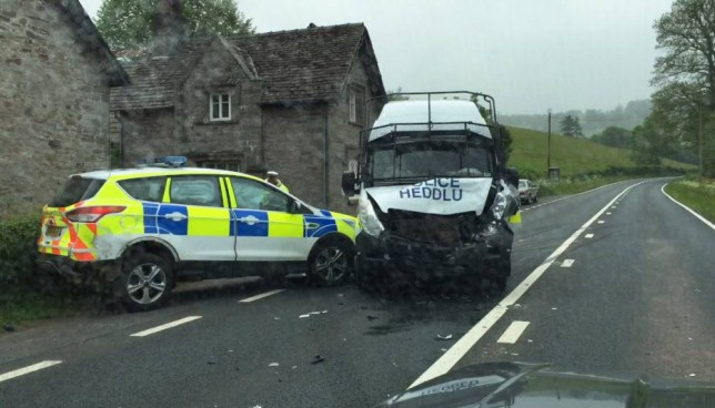 Police drivers were left red-faced when two cop cars smashed into each other on a quiet country road. An investigation was launched into how the crash happened in broad daylight with little traffic around. Somehow the police Vauxhall van spun into the Ford Kuga patrol car as they travelled in the same direction. © WALES NEWS SERVICE