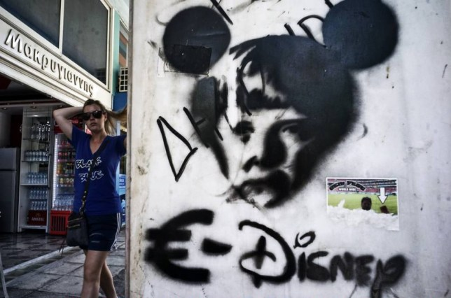 ATHENS, GREECE - JUNE 15: Graffiti showing German Cancellor Angela Merkel as a mouse to compare the European Union with Disney on June 15, 2015 in Athens, Greece. The European Commission has said that Greece and its international creditors need to come to an agreement within the next 2 weeks to avoid a possible default, after weekend talks collapsed. (Photo by Milos Bicanski/Getty Images)