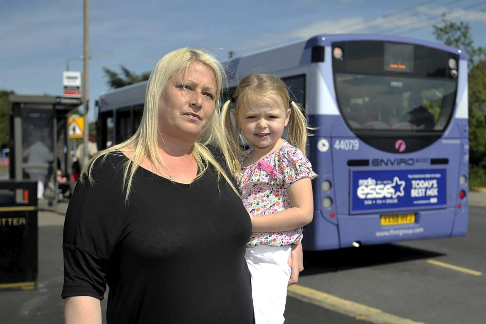 FROM JOHN JEFFAY AT CASCADE NEWS LTD    0161 660 8087 /  07771 957773  john@cascadenews.co.uk / www.cascadenews.co.uk Syndicated for Basildon Echo PIC: Laura Pulley with daughter Lola Wright-Pulley with the no22 bus in the backgroud. A BUS driver called the POLICE when a mum tried to pay part of her 60p fare in pennies. Laura Pulley, 35, boarded the number 22 bus in Long Road, Canvey, Essex, with her four-year-old  daughter Lola.  She tried to pay the 60p fare using about 25p in coppers, but the male driver refused to accept the  money, stating he was legally entitled to only accept 20p in coppers.  When Laura stood her ground on the bus, the driver called the police.