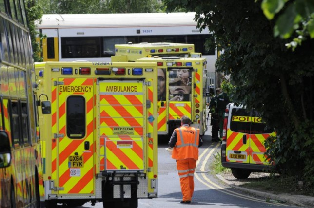 """Emergency crews at Chartham train station, Kent where a man has been killed this morning after being hit by a train.  See MASONS story MNTRACKS; A man has died and a woman is being treated in hospital after they were hit by a train at a station yesterday (Tues) morning. One online comment claimed that the man was 'an absolute hero' who had tried to rescue the woman. The two casualties were seen on the London-bound platform at Chartham, Kent moments before they were struck on the tracks at 10.55am. British Transport Police said they were treating the incident as """"unexplained"""" as scores of emergency workers raced to the scene."""