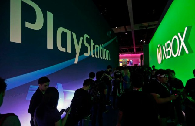 Attendees arrive at the opening at the E3 Electronic Entertainment Expo at Los Angeles Convention Center on Tuesday, June 16, 2015. (AP Photo/Damian Dovarganes)