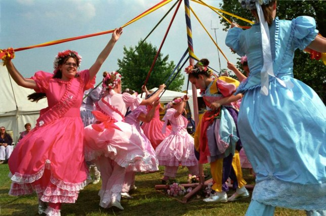 Children dancing around the Maypole at a summer fair in Dulwich park, London.