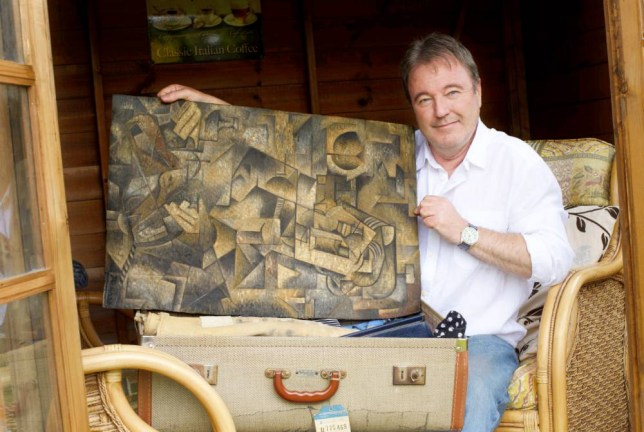 Dominic Currie with the painting he found in his dead mother's suitcase - he believes the Cubist canvas is a Pablo Piccaso original. See Centre Press story CPOIL;  A man has discovered an oil painting in his attic which may be by the world's greatest twentieth century artist, Pablo Picasso. Dominic Currie, 58, found the cubist portrait that had lain untouched in a suitcase for 55 years and had considered throwing it on a skip. It had belonged to his mother, who revealed only two years before she died that, during the Cold War, she had fallen pregnant to a Russian soldier. She also revealed her Soviet lover had gifted her a painting but Dominic dismissed her story as fantasy - until he opened the suitcase himself. Dominic, an artist-in-residence at Kirkcaldy's Sailor's Walk Gallery said: ìI saw a roll of cloth and thought that was the actual painting then realised there was a canvas rolled up inside.