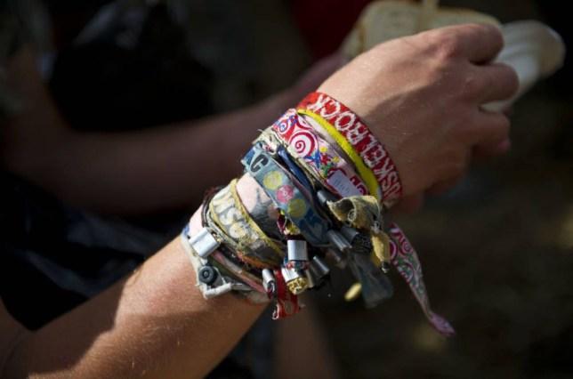 Mandatory Credit: Photo by James McCauley/REX Shutterstock (1351201x)  A festival-goers wristbands  Glastonbury Festival, Somerset, Britain - 25 Jun 2011