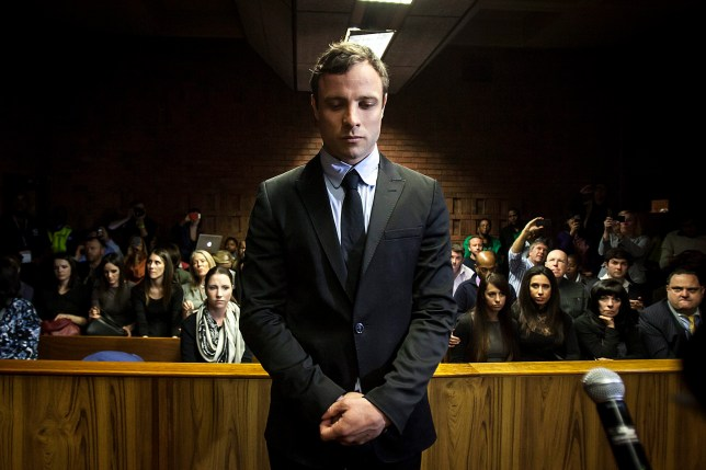 Olympic sprinter Oscar Pistorius (C) appears in the Pretoria Magistrates court in Pretoria, South Africa, 19 August 2013. The trial of double-amputee Olympic sprinter Oscar Pistorius, accused of the premeditated murder of his girlfriend Reeva Steenkamp, will begin on 03 March 2014, a judge ruled on 19 August 2013. Judge Desmond Nair set the trial to run through March 20 next year at a high court in Pretoria, in coordination with defence lawyers and the prosecution. epa03830502 EPA/STR